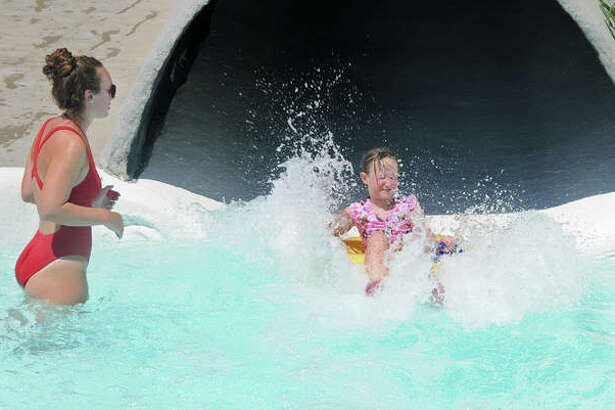 Raging Rivers Waterpark employee Olivia Yoswig, of Jerseyville, waits for young people at the bottom of a water slide in July. The popular waterpark in Grafton has new owners and expansion plans for the 2021 season.
