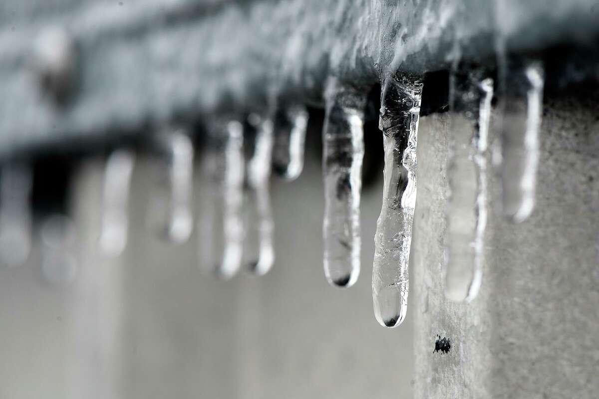 Icicles hang off a ledge as freezing rain hits Beaumont on Tuesday. Photo taken Tuesday 1/16/18 Ryan Pelham/The Enterprise