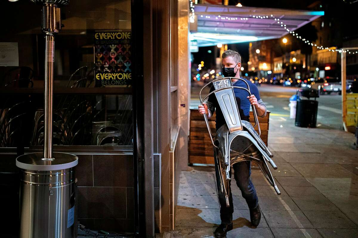Manager Shane Baldwin removes the outdoor dining area and closes Myriad Gastropub in San Francisco on Nov. 20.