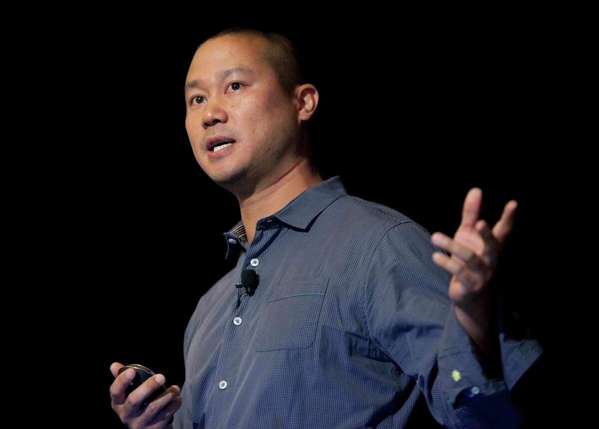 FILE - In this Sept. 30, 2013, file photo, Tony Hsieh speaks during a Grand Rapids Economic Club luncheon in Grand Rapids, Mich. Hsieh, retired CEO of Las Vegas-based online shoe retailer Zappos.com, has died. Hsieh was with family when he died Friday, Nov. 27, 2020, according to a statement from DTP Companies, which he founded. Downtown Partnership spokesperson Megan Fazio says Hsieh passed away in Connecticut, KLAS-TV reported. Hsieh recently retired from Zappos after 20 years leading the company. He worked to revitalize the Las Vegas area.