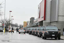 A line of Edwardsville Police vehicles parks in front of the local Target during a previous year's Christmas with a Cop event.