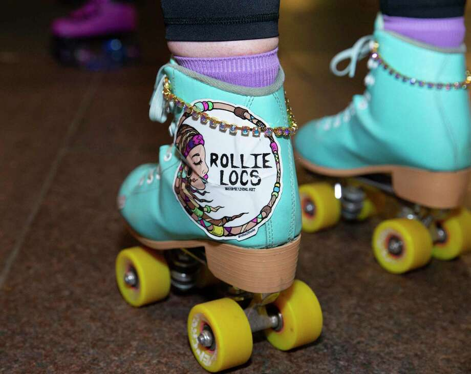 The Space City Roller, a Houston-based girl group of roller skaters, have fun with a Friday night skate Friday, Nov. 20, 2020, at Discovery Green in downtown Houston. Photo: Yi-Chin Lee, Houston Chronicle / Staff Photographer / © 2020 Houston Chronicle