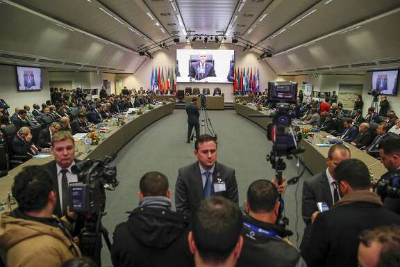 Security personnel stand in front of the media ahead of the 177th Organization of Petroleum Exporting Countries (OPEC) meeting in Vienna on Dec. 5, 2019. Ministers gather virtually this year. MUST CREDIT: Bloomberg photo by Stefan Wermuth