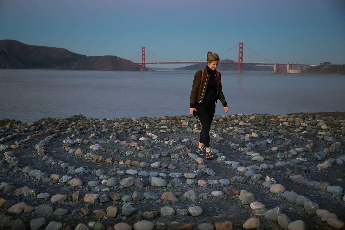 Bryn Bartley walks the Labyrinth by SF artist Eduardo Aguilera at Lands End Point on Thursday, Dec. 6, 2018, in San Francisco, Calif.