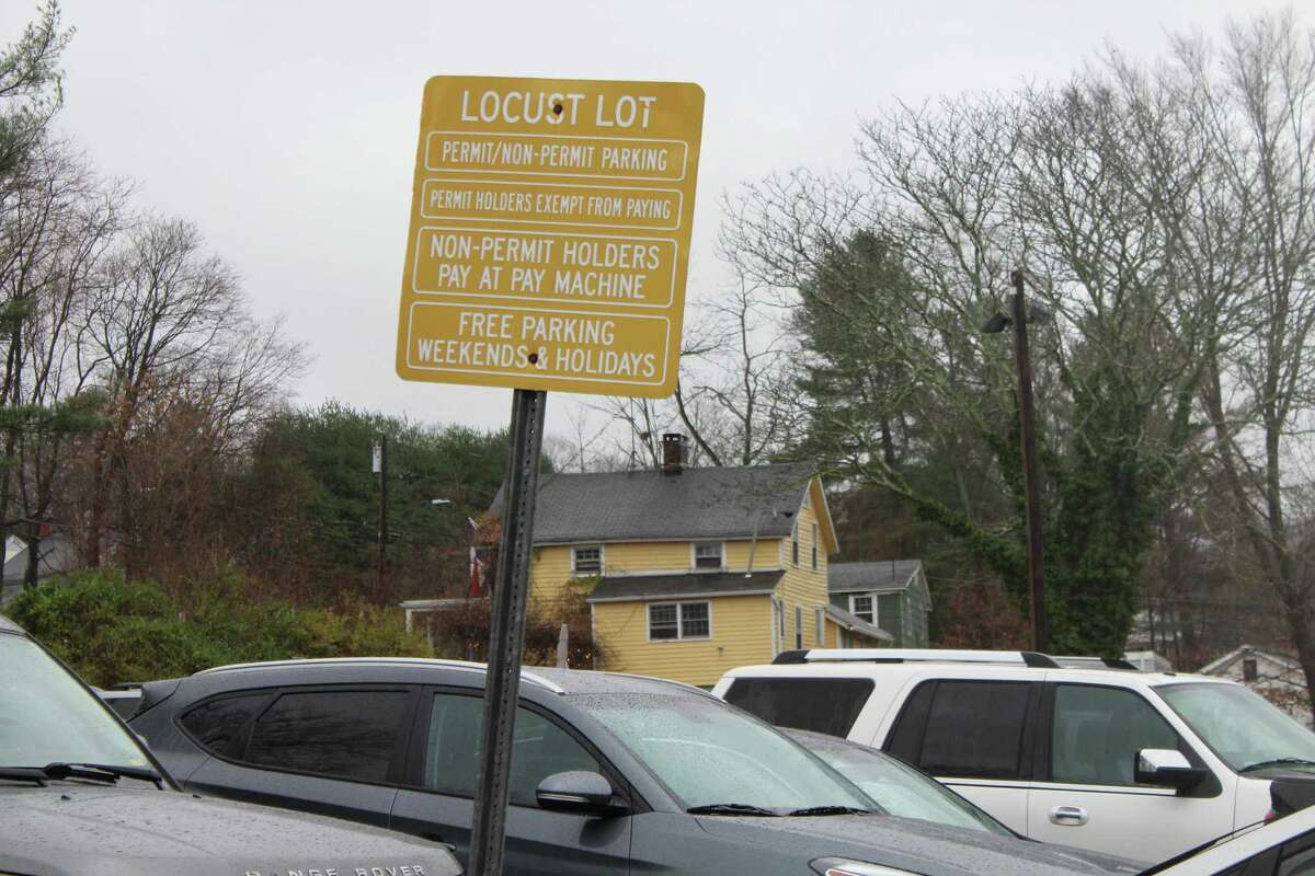 Downtown workers could soon get free permits for the Locust Avenue parking lot, an effort to open spots closer to stores for patrons.