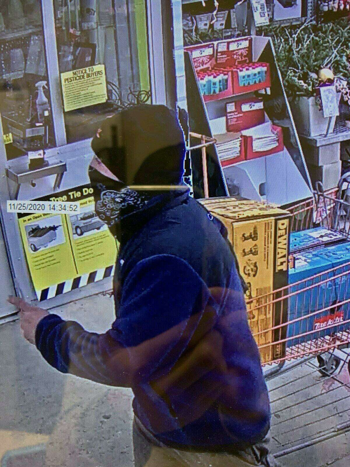 Police are looking for a man who they say pulled a knife on Home Depot employees when they confronted him about shoplifting.