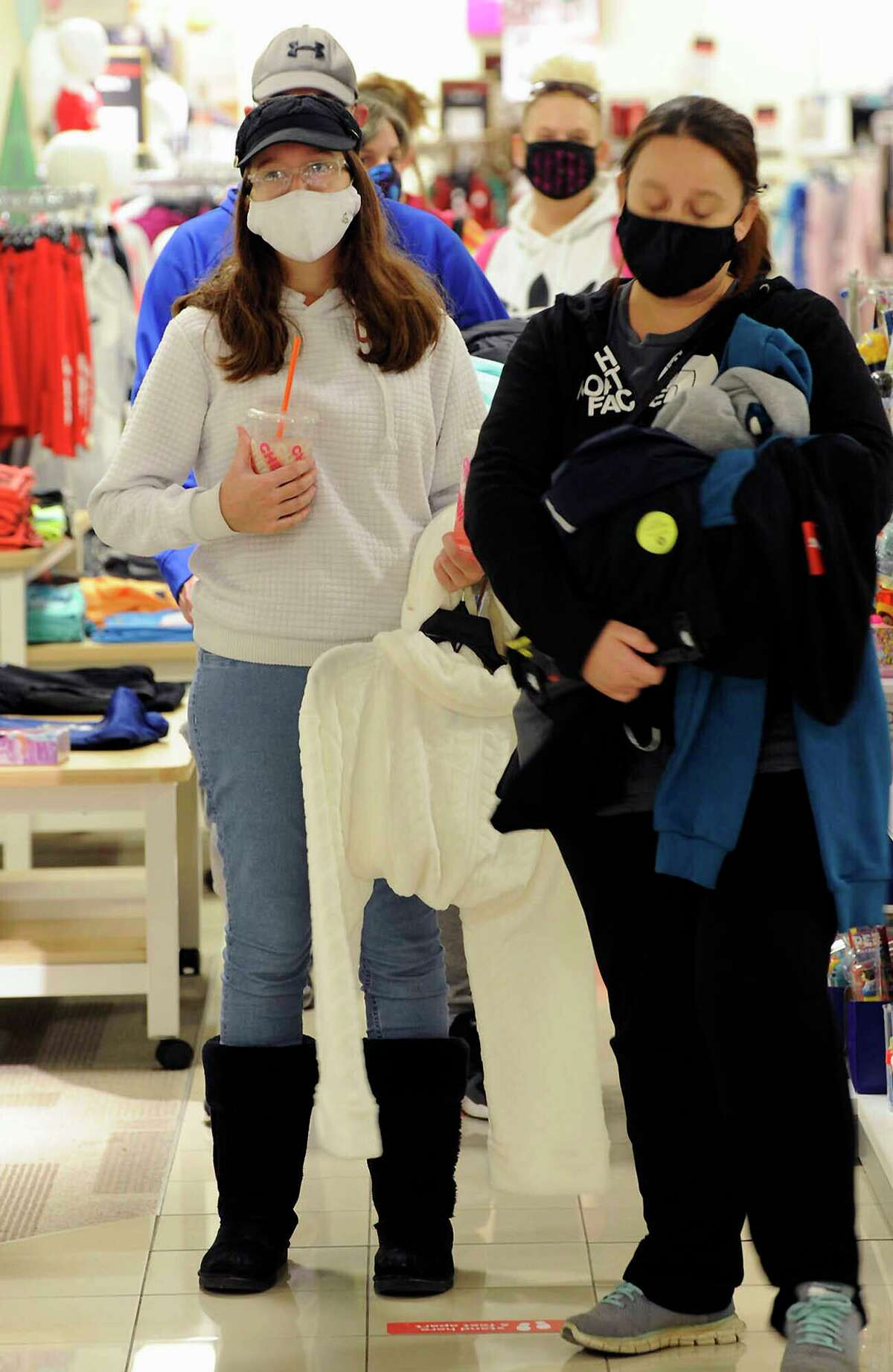 Shoppers wait in line at a JC Penney store in the Wyoming Valley Mall on Black Friday, in Wilkes-Barre, Pa., Friday Nov. 27, 2020. (Mark Moran/The Citizens' Voice via AP)