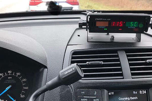 The radar unit of an Illinois State Police car shows the speed of a driver stopped on Interstate 72 locked in at 115 mph.