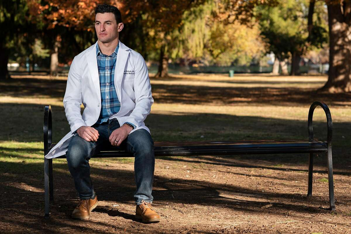 Taylor Nichols, an emergency physician, poses for a portrait at McKinley Park in Sacramento, Calif. on Monday November 30, 2020. Taylor Nichols is a Jewish ER doctor, from the Bay Area, now at a hospital near Sacramento who wrote a gut-wrenching twitter post about treating a Nazi guy who likely had covid and his hesitancy and exhaustion.