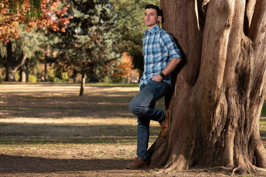 Taylor Nichols, an emergency physician, poses for a portrait at McKinley Park in Sacramento, Calif. on Monday November 30, 2020. Taylor Nichols is a Jewish ER doctor, from the Bay Area, now at a hospital near Sacramento who wrote a gut-wrenching twitter post about treating a Nazi guy who likely had covid and his hesitancy and exhaustion. Photo: Salgu Wissmath / Special To The Chronicle