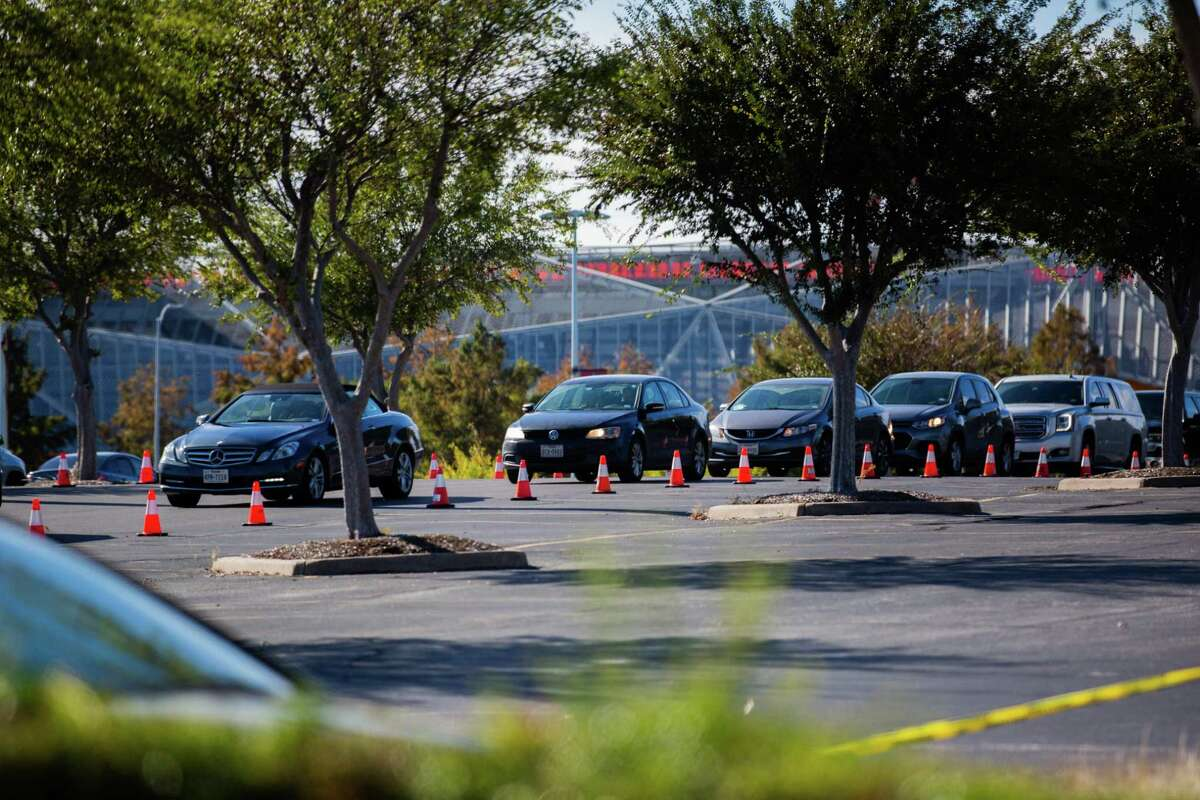 Cars line up on Minute Maid Park (Lot C) at 2208 Preston Street waiting to get tested for COVID-19, Monday, Nov. 30, 2020, in Houston.