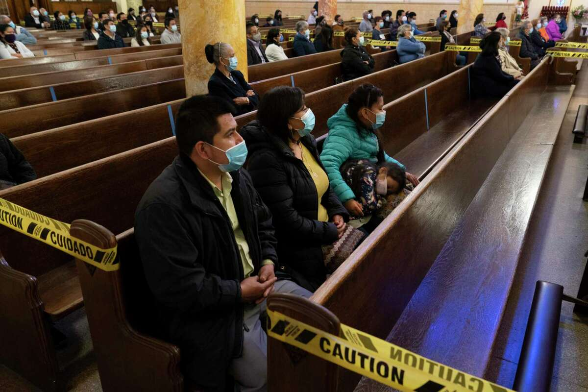FILE -- Congregants sit in distanced groups during a service at St. Agatha Church in Brooklyn, Oct. 25, 2020. Gov. Andrew Cuomo accused the U.S. Supreme Court of political partisanship on Nov. 26 morning after the high court rejected his coronavirus-based restrictions on religious services. (James Estrin/The New York Times)