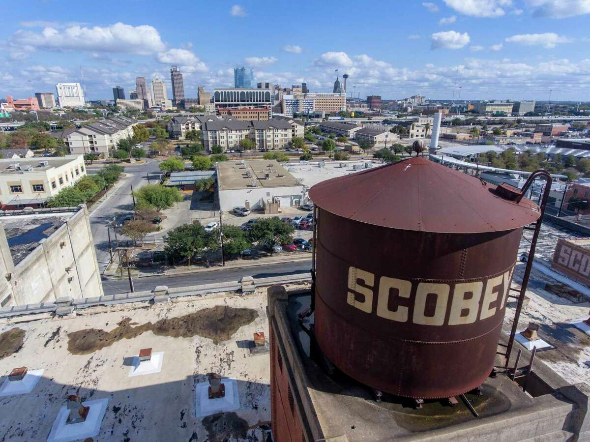 Downtown San Antonio is seen Nov. 23, 2020 behind the Scobey complex on the city's near West Side.