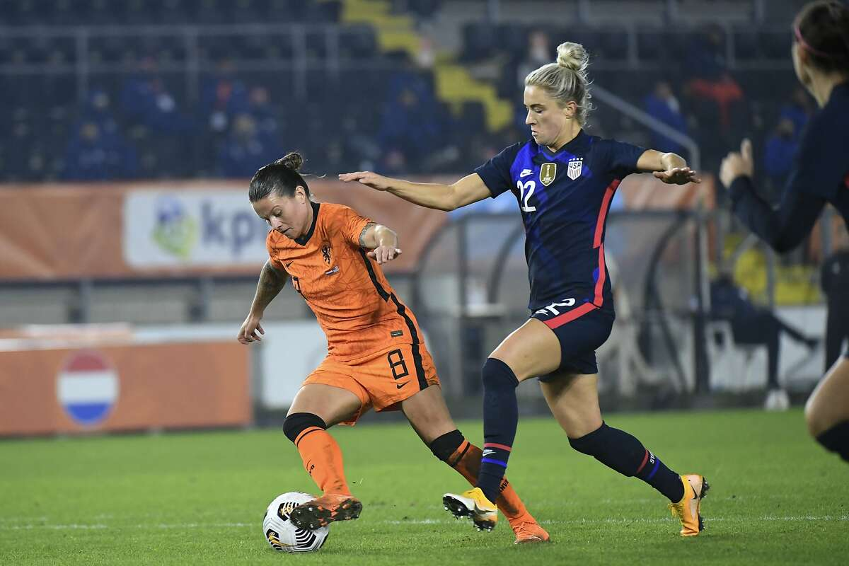 Kristie Mewis vies for the ball with Netherlands' Sherida Spitse (8) on Friday. Mewis had a goal as the U.S. won 2-0.