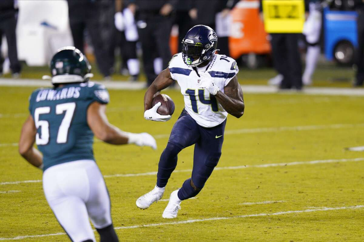 Seattle Seahawks' DK Metcalf plays during the first half of an NFL football game against the Philadelphia Eagles, Monday, Nov. 30, 2020, in Philadelphia. (AP Photo/Chris Szagola)