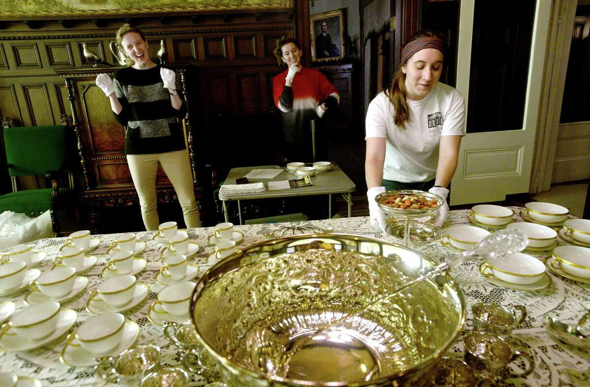 McFaddin-Ward House Museum staff, including (from left) Kara Timberlake, Ashley Thornton and Emily Fischer, joke as they perfect the breakfast room table display while decorating the historic home Monday as they prepare for the opening of this weekend's Christmas photo event Sunday and holiday tours. Photo taken Monday, November 30, 2020 Kim Brent/The Enterprise
