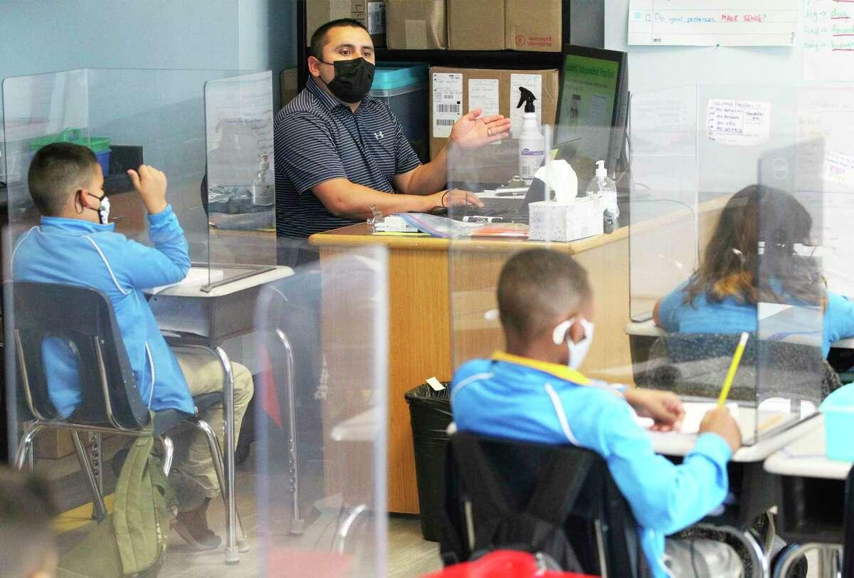 Master teacher Armando Vela keeps second grade math students on their toes as IDEA Carver Academy on Monday.