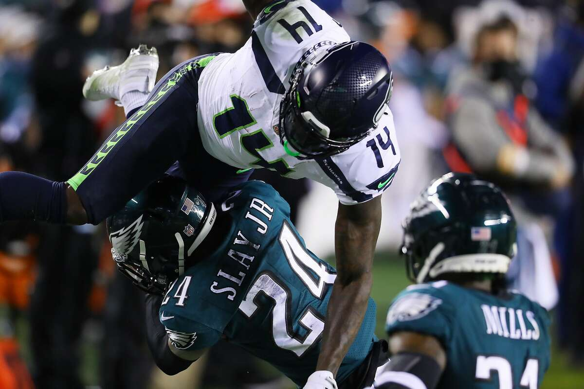 PHILADELPHIA, PENNSYLVANIA - NOVEMBER 30: DK Metcalf #14 of the Seattle Seahawks goes up and over Darius Slay #24 of the Philadelphia Eagles during the second quarter at Lincoln Financial Field on November 30, 2020 in Philadelphia, Pennsylvania. (Photo by Mitchell Leff/Getty Images)