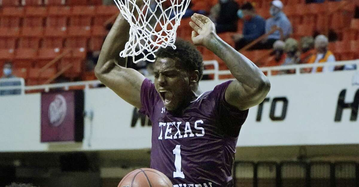 Texas Southern forward Galen Alexander (1) dunks in front of Oklahoma State forward Matthew-Alexander Moncrieffe (12) during the first half of an NCAA college basketball game in Stillwater, Okla., Saturday, Nov. 28, 2020. (AP Photo/Sue Ogrocki)