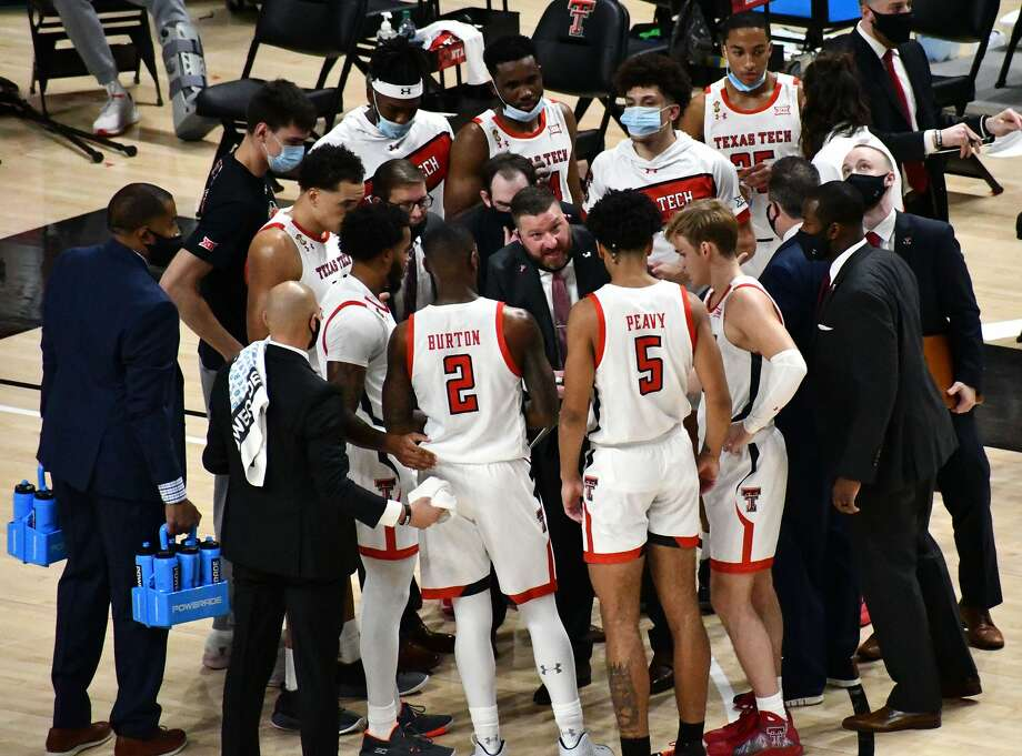 Texas Tech head coach Chris Beard talks strategy with his players during the season opener against Northwestern State. Photo: Nathan Giese/Planview Herald