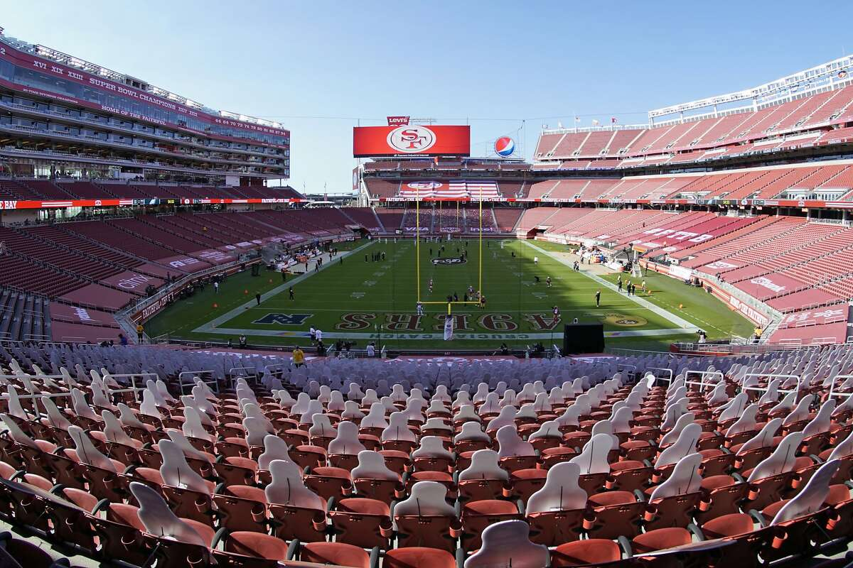 This Oct. 4, 2020, file photo, taken with a fisheye lens, shows an empty Levi's Stadium before an NFL football game between the San Francisco 49ers and the Philadelphia Eagles in Santa Clara, Calif.