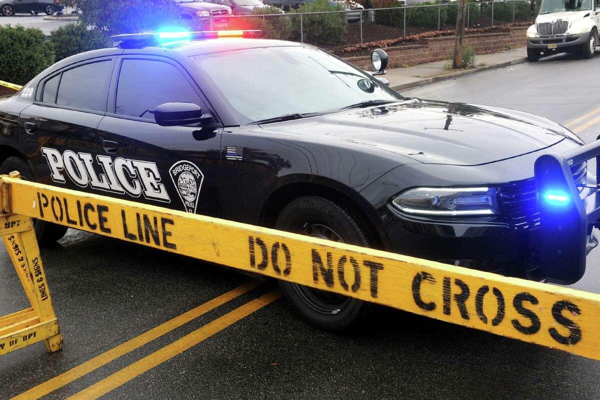 A file photo of a Bridgeport, Conn., police cruiser at a crime scene.