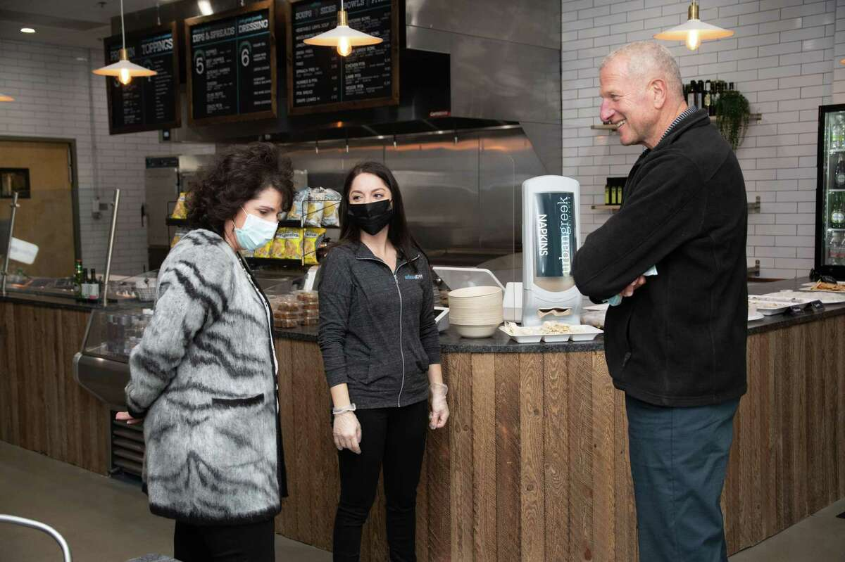 Sophia Diakoloukas, owner of Urban Greek at 702 Bridgeport Ave., speaks with Mayor Mark Lauretti at the grand opening of her eatery Nov. 16.