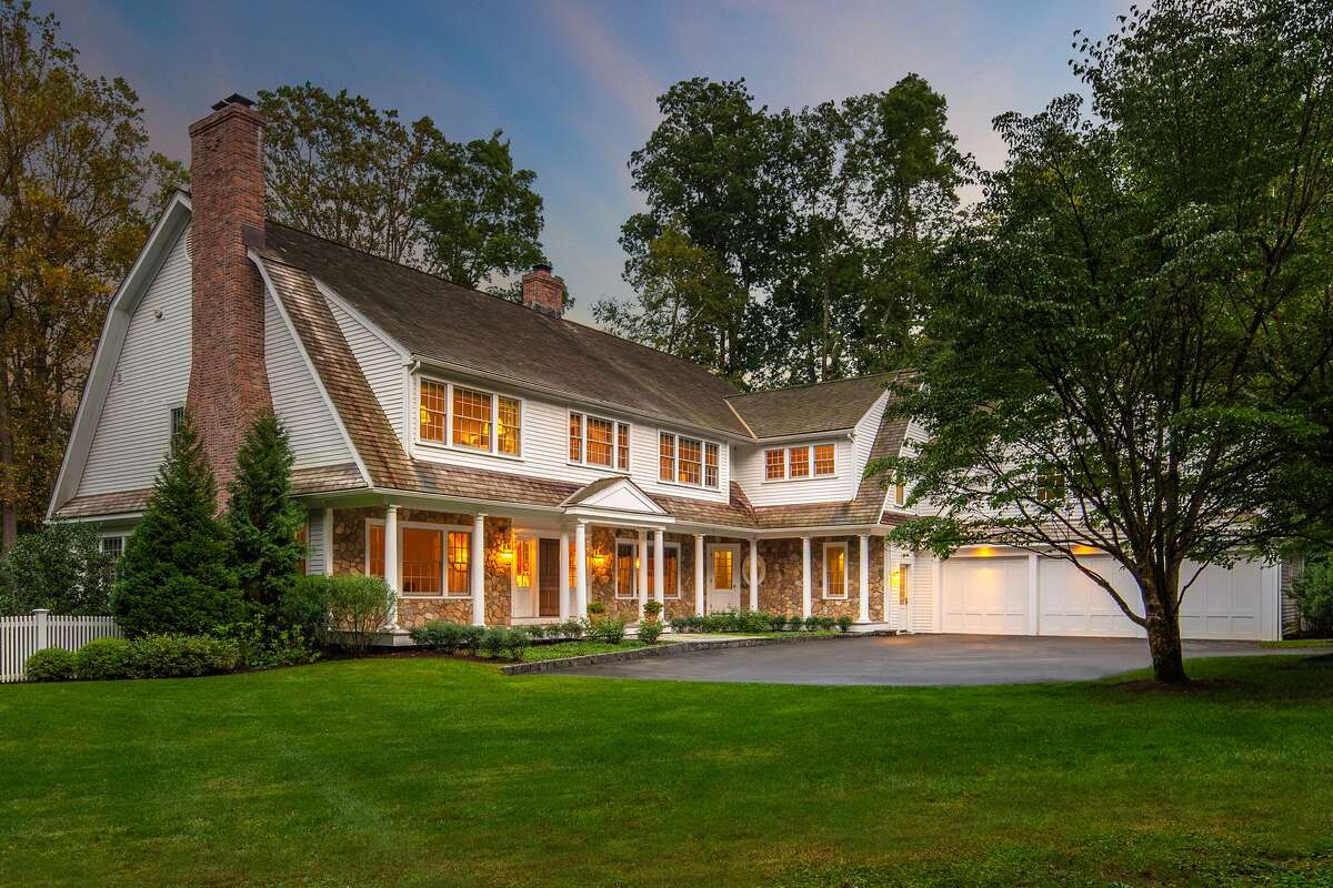 The stone and wood colonial house at 6 Cobble Hill Road sits on a one-acre level property on a cul-de-sac in Westport's Old Hill neighborhood. It was built in 2012 with modern amenities