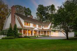 The stone and wood colonial house at 6 Cobble Hill Road sits on a one-acre level property on a cul-de-sac in Westport's Old Hill neighborhood.