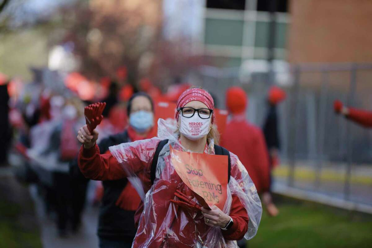 Albany Med Nurses and their supporters picket outside the hospital as part of a one-day strike on Tuesday, Dec. 1, 2020, in Albany, N.Y. (Paul Buckowski/Times Union)