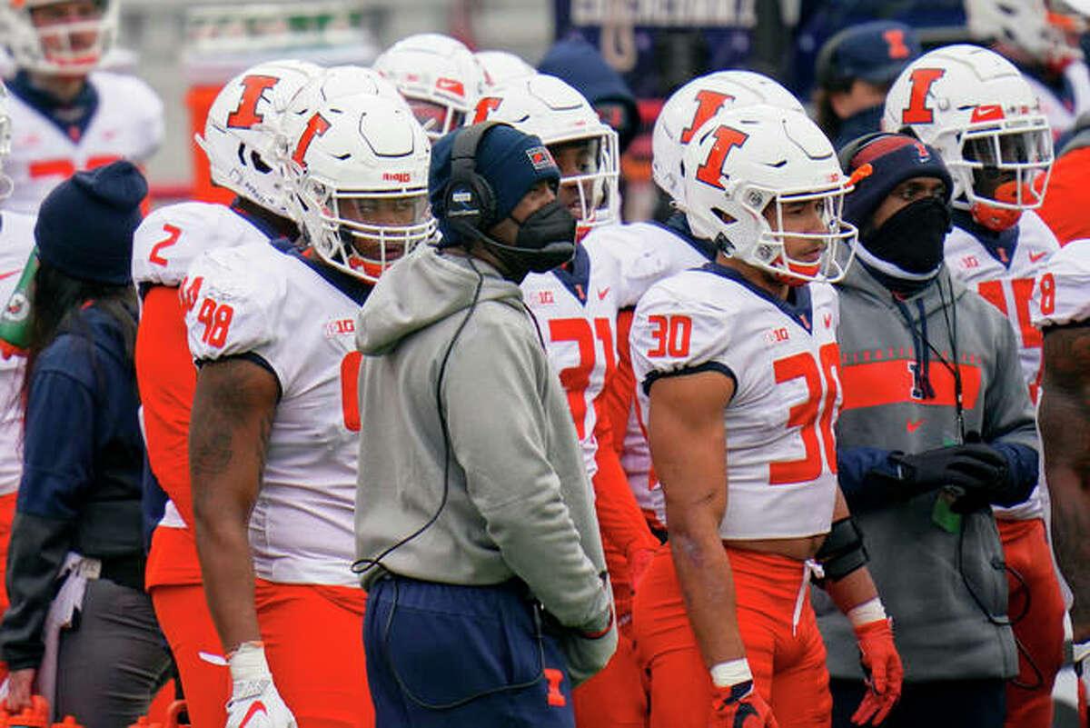 Illinois head coach Lovie Smith follows the first half of an NCAA college football game against Nebraska in Lincoln, Neb., Saturday, Nov. 21, 2020.