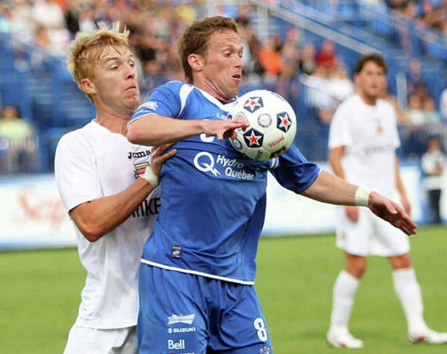 Edwardsville graduate Luke Kreamalmeyer, right, of the Montreal Impact tries to control the ball against the Fort Lauderdale Strikers in NASL action in July 2011 in Montreal. Photo: For The Intelligencer