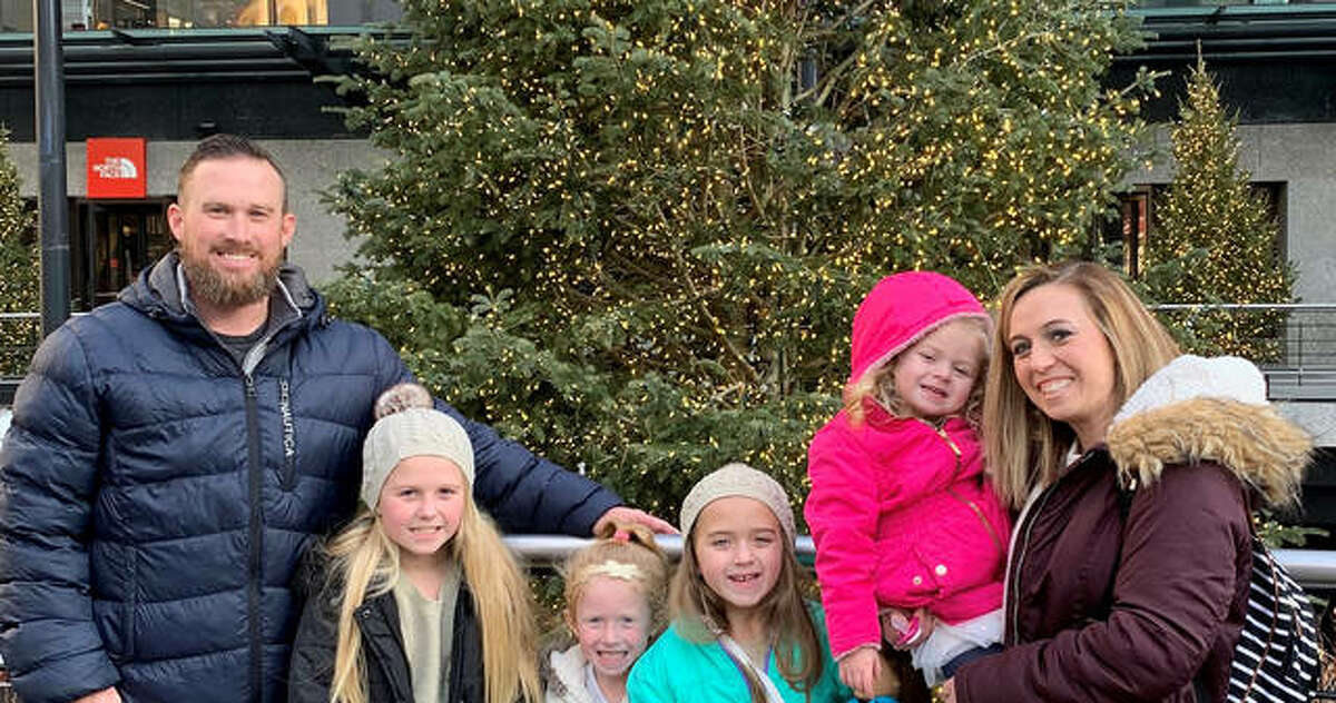 Edwardsville graduate Luke Kreamalmeyer, left, with his wife, Corrine, and their daughters, Lexi, Bria, Isla and Harper.