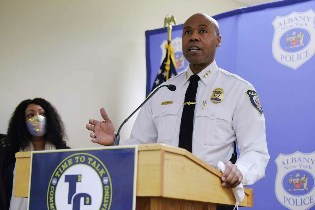 Albany Police Chief Eric Hawkins speaks at a press conference to announce the launch of Time to Talk - Community and Cops Collaborating, on Tuesday, Dec. 1, 2020, in Albany, N.Y. The program will allow for police officers and community members to meet on a regular basis to discuss the issues impacting the relations between police and the community. Albany resident April Purcell-Bacon, background, played a major role in starting the program. (Paul Buckowski/Times Union)