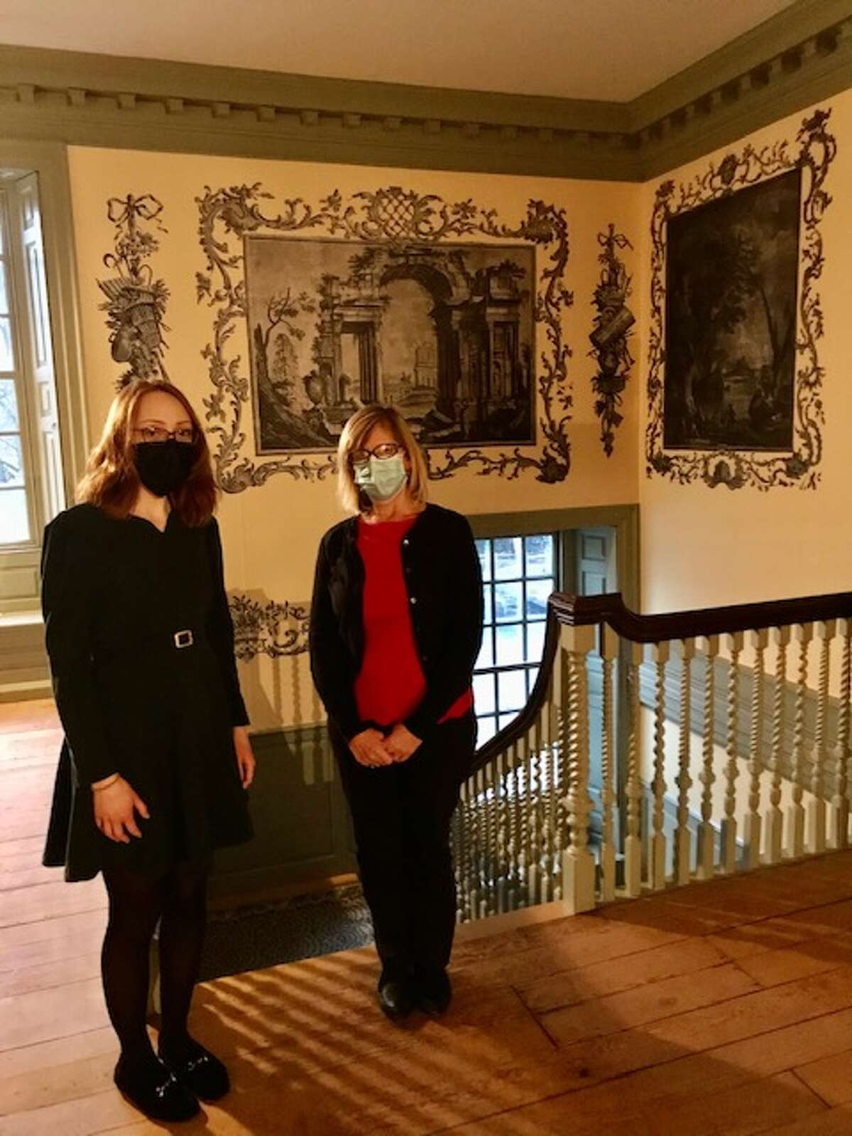 essie Serfilippi, interpreter, and Heidi Hill, site manager, on the second-floor landing in the Schuyler Mansion, where tours include new research on the slave-owning past of the Schuyler family and Alexander Hamilton.