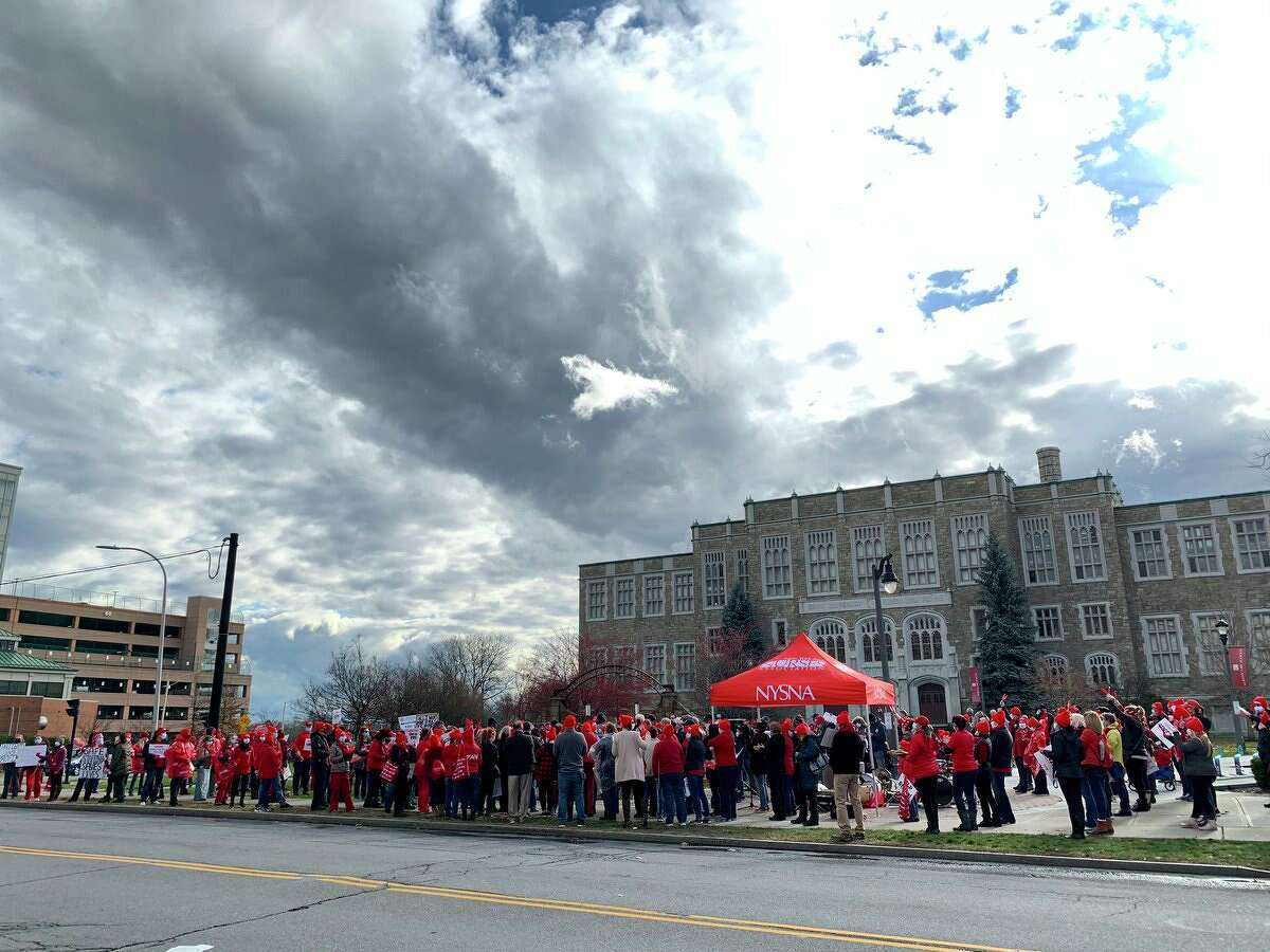 Nurses picket outside Albany Medical Center on Tuesday. The nurses union went on strike at 7 a.m. amid a contract stalemate with hospital leaders and what they describe as unhealthy sanitary conditions at the hospital.