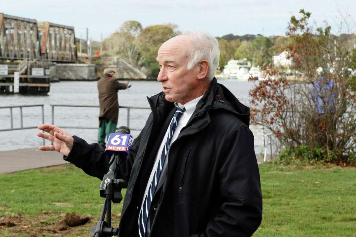 U.S. Rep. Joe Courtney at the DEEP Marine Headquarters at Ferry Landing State Park in Old Lyme with the Amtrak bridge in the background.
