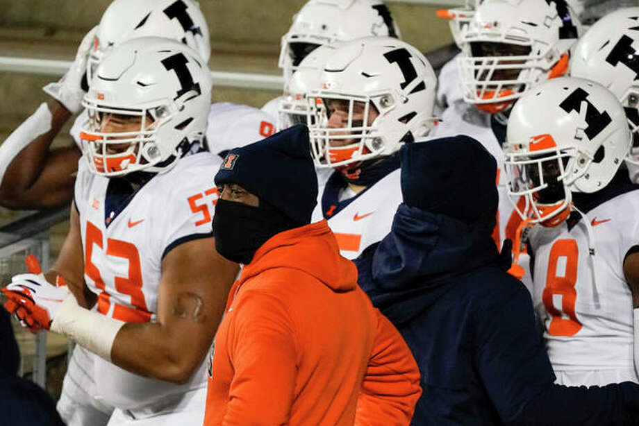 Illinois coach Lovie Smith waits with his team to be introduced before an Oct. 23 Big Ten Conference game vs. Wisconsin in Madison, Wis. The Illini are home this Saturday to play Iowa. Photo: Associated Press