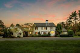 The beige contemporary colonial house at 2345 Redding Road, Fairfield, sits several properties away from the place that Pulitzer Prize winning novelist and poet Robert Penn Warren called home for 38 years.