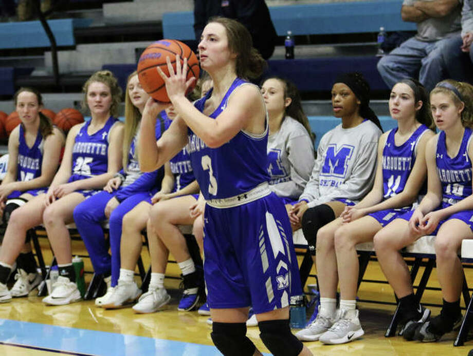 Marquette Catholic's Kamryn Fandrey sets to launch a 3-pointer while teammates look on from the bench during a game at the Jersey Holiday Tourney last season at Havens Gym in Jerseyville. Photo: Greg Shashack / The Telegraph