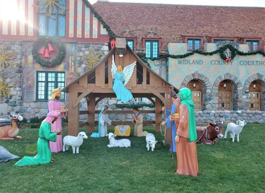 The Midland Area Community Foundation leases space at the Midland County Courthouse each year to set up holiday décor, including the nativity scene which was finished this week.(Ashley Schafer/ashley.schafer@hearstnp.com)
