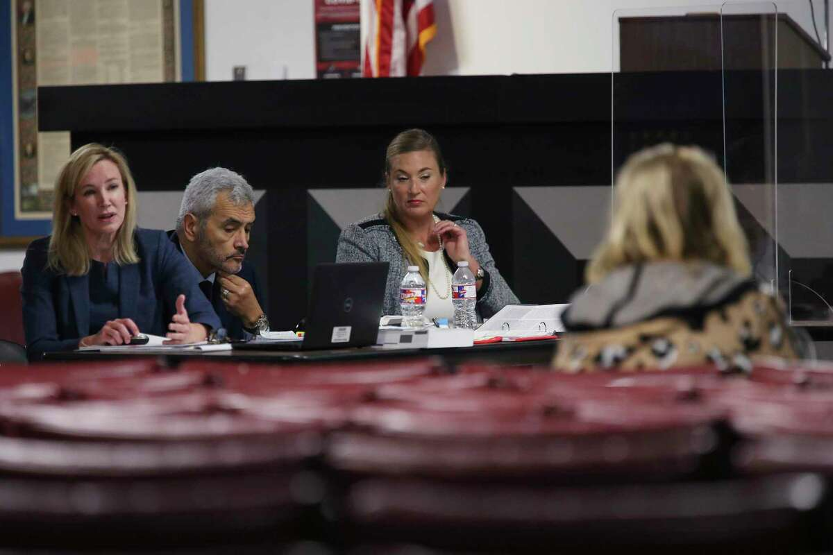 Prosecutors, from left, Tamara Strauch, Mario Del Prado and Jessica Schulze question a prospective juror for the approaching capital murder trial of Otis McKane, at the Bexar County Central Jury Room before state District Judge Ron Rangel on Monday. McKane is accused of killing San Antonio Police Det. Benjamin Marconi in 2016. Jury selection started in March but was halted due to the COVID-19 pandemic, and the trial itself might not start until after January, 2021.