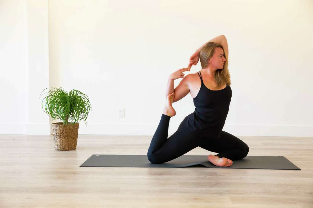 Yoga Instructor Katie Canfield demonstrates a yoga pose in the new Core Burn Pilates Yoga studio in New Canaan. It is the sixth Core Burn location, and the first one with both Pilates and Yoga. It opened fall 2020.