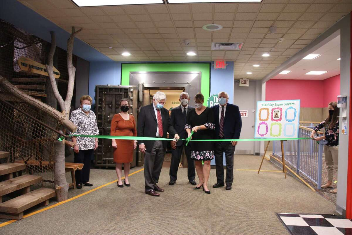 From left are Joann Ryan, NWCT Chamber of Commerce, Eileen Marriott, Museum Director, Ken Merz, President of KidsPlay, Edwin G. Booth, Jr., Chairman of the Board of Trustees Torrington Savings Bank, Lesa A. Vanotti, Torrington Savings Bank President & CEO, and John E. Janco, Sr., Torrington Savings Bank CEO Emeritus. The group was celebrating the opening of the museum's new bank exhibit.