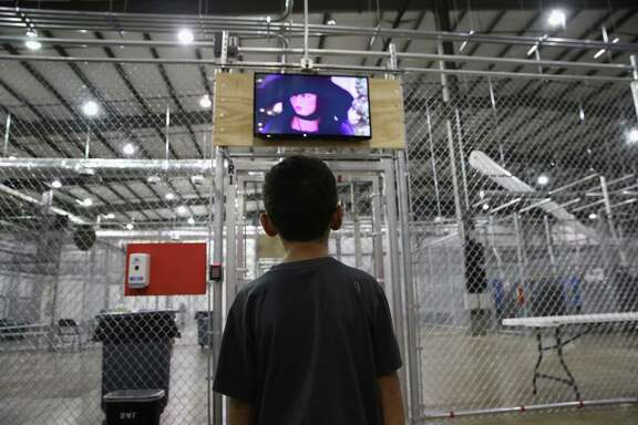 A boy from Honduras watches a movie at a detention facility run by the U.S. Border Patrol in 2014. Letter writers say the Flores settlement should be modified to ensure children receive proper legal representation, medical attention and safe and secure housing.