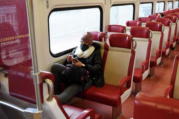 Metro-North passengers ride the local train between Greenwich and Stamford, Conn. on Tuesday, Dec. 1, 2020. New Haven Line ridership is down 80 percent and service has been reduced 38 percent as the railroad awaits crucial federal aid.