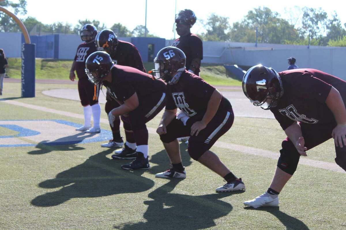 Heights offensive linemen group warming up for a district game earlier this season.