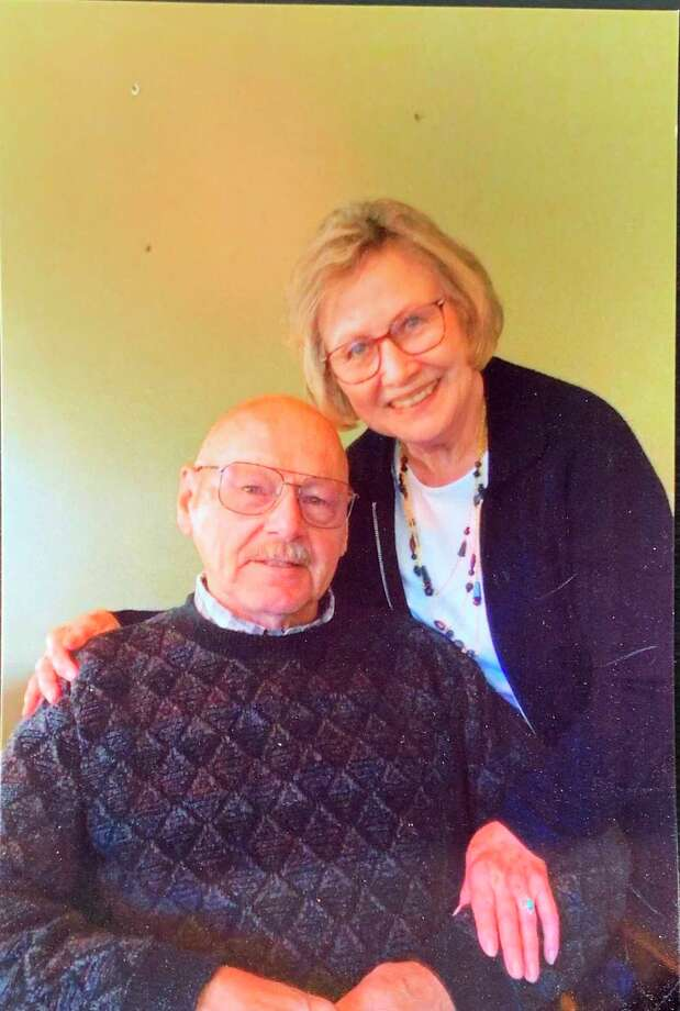 """Pat and Bob Holzhausen pose for a photo for their 65th wedding anniversary. Married at 18, their marriage has been a lasting love affair. Pat said, """"We like the outdoors, finding out what's around the bend."""" (Photo Provided)"""