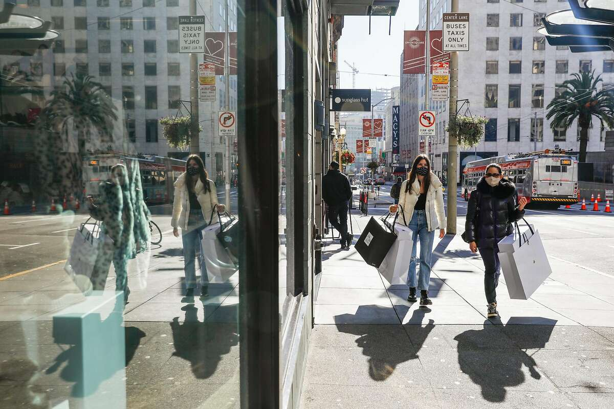 Scarlett Reicher,18, (left) and mom Wendy Reicher (right) shop in Union Square on Tuesday, Dec. 1, 2020 in San Francisco, California.