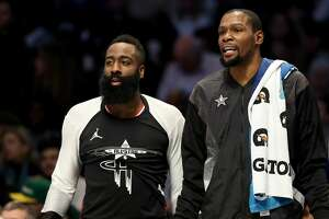 CHARLOTTE, NORTH CAROLINA - FEBRUARY 17: James Harden #13 of the Houston Rockets and teammate Kevin Durant #35 of the Golden State Warriors and Team LeBron watch on from the bench during the NBA All-Star game as part of the 2019 NBA All-Star Weekend at Spectrum Center on February 17, 2019 in Charlotte, North Carolina.